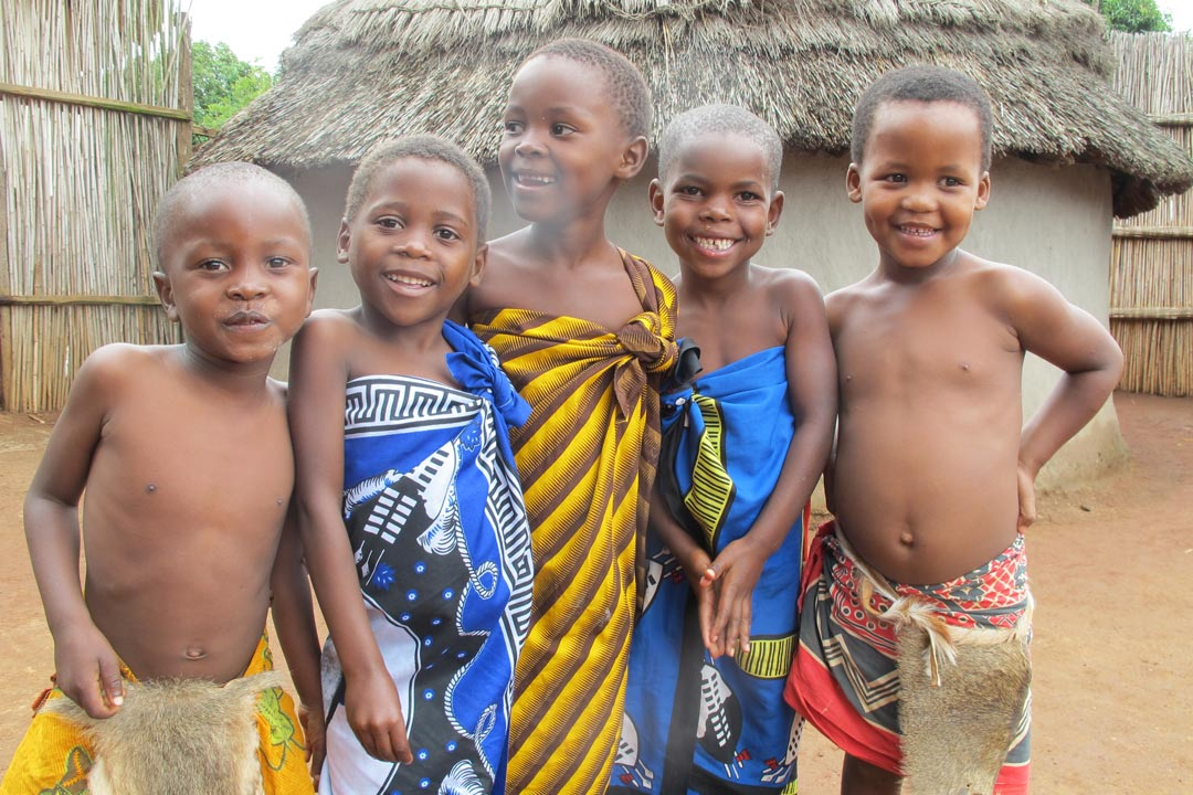 A group of Swazi children smiling towards the camera
