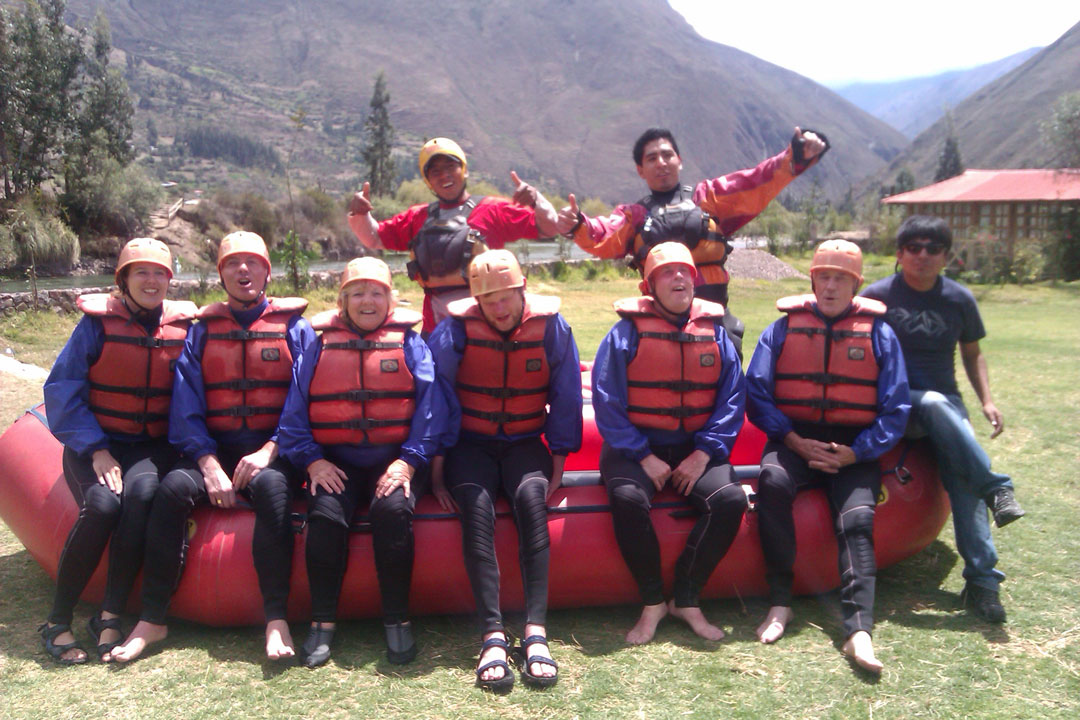 The Traveleyes group with our tour guides sitting on their raft.