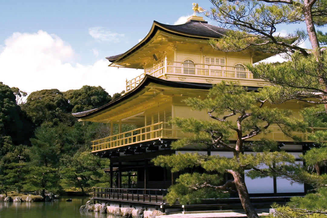 A gold plated Japanese temple by a lake