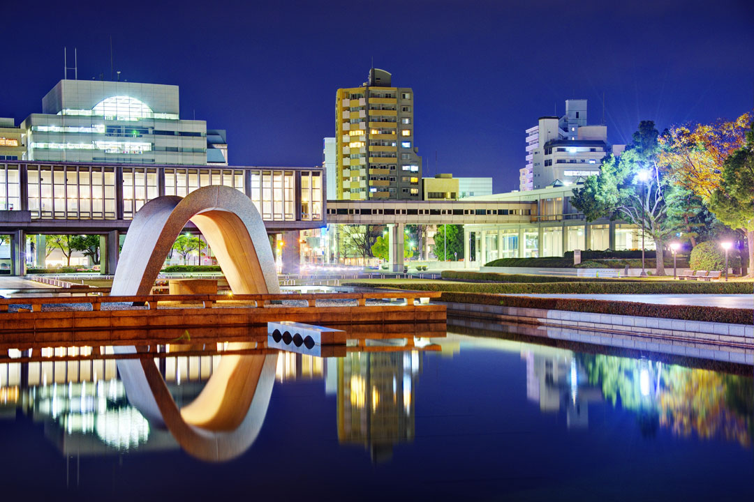Modern buildings reflected in a lake in Hiroshima