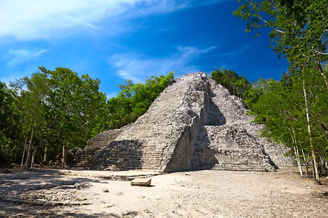 A temple pyramid ruin at the archaeological site of Coba, an ancient Maya city on the Yucatán Peninsula, Mexico