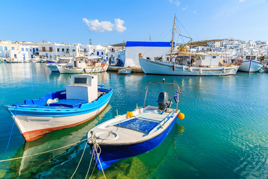 Two fishing boats moored in turquoise waters in Mykonos Harbour