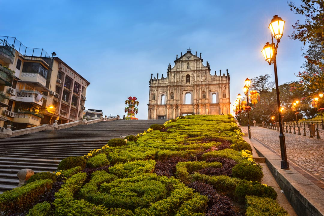 The Cathedral facade in Macau sitting atop a hill at dusk