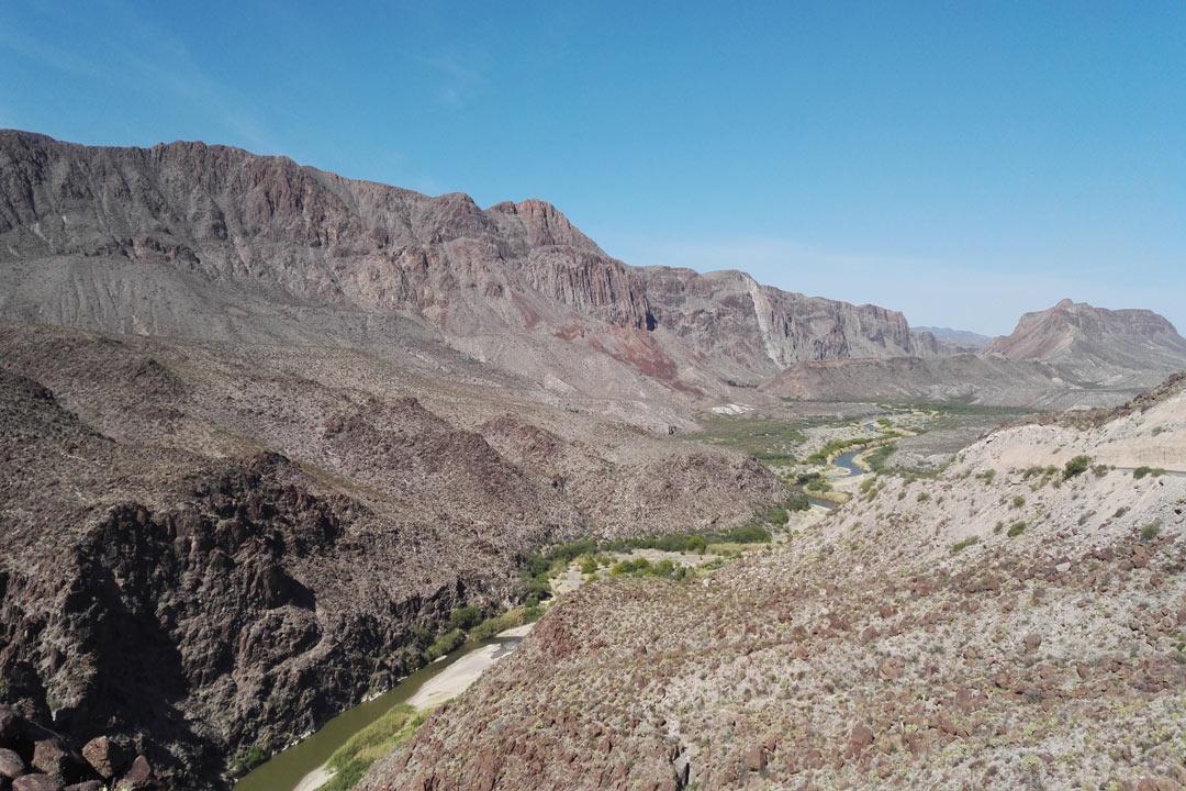 A winding river going through a deep barren valley