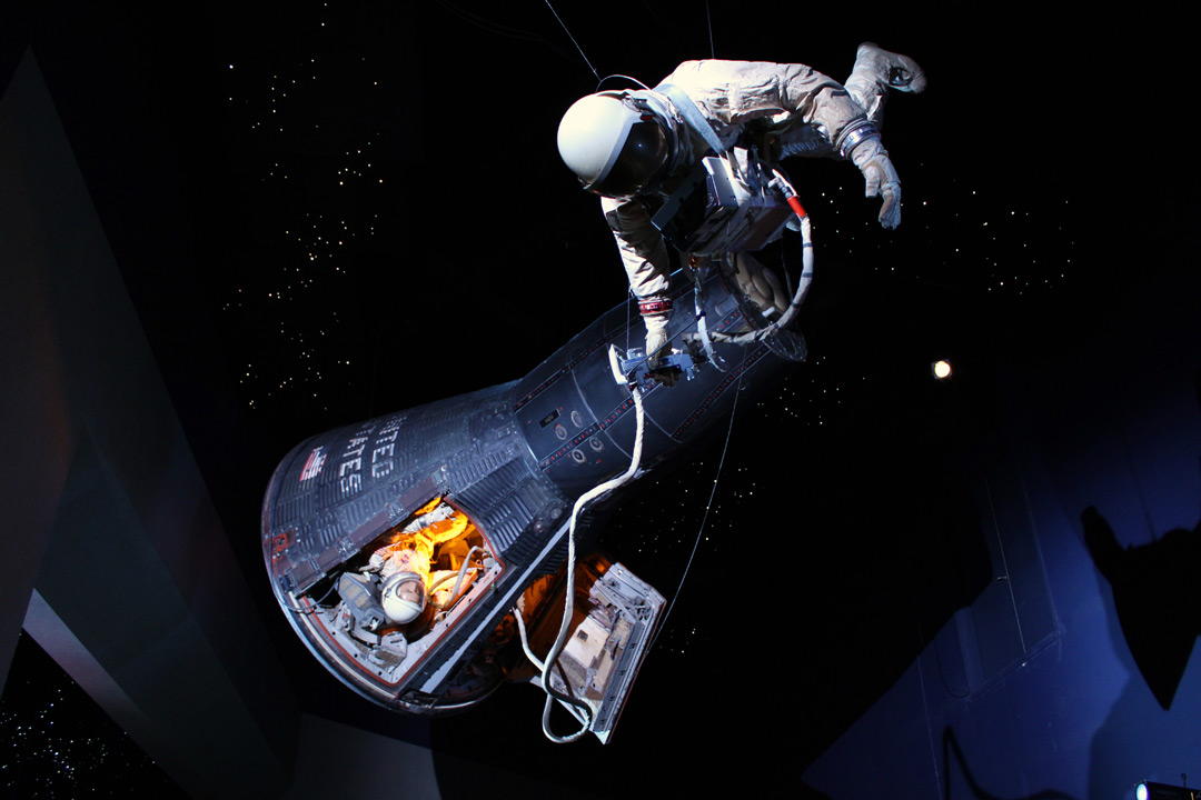 An exhibit showing an astronaut and space ship floating in space