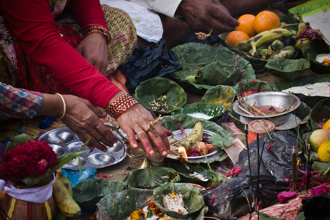 A Nepalese family tucking into traditional dishes and fruits