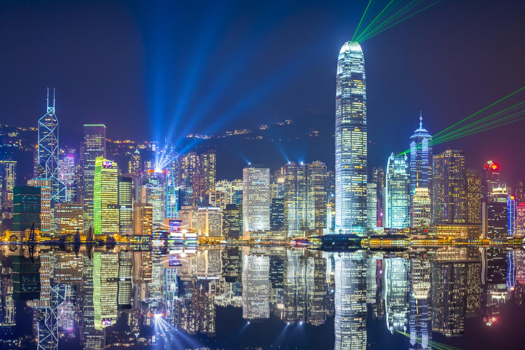 The Hong Kong skyline lit up for their night time light show which reflects in the water of Victoria Harbour