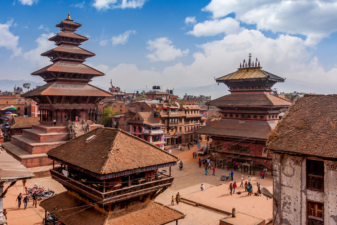 Traditional Asian buildings with tiered red roofs in Kathmandu