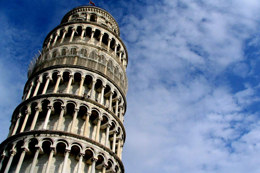 The leaning tower of Pisa, Its rows of marble archways and pillars back on to a brilliant blue sky.