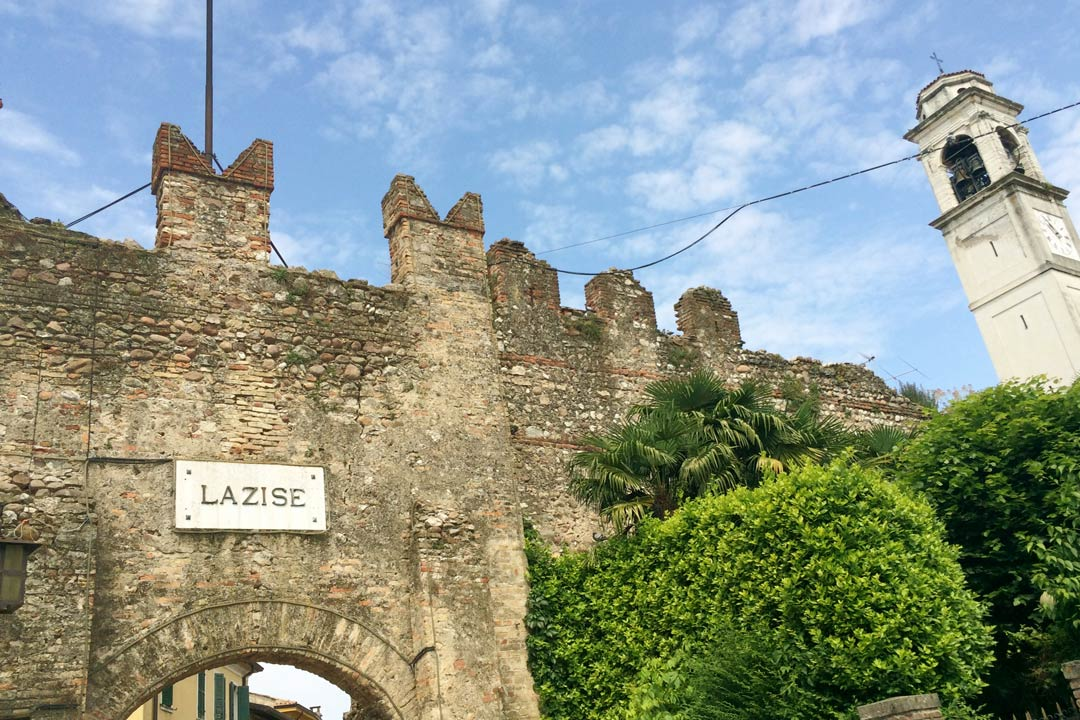 The medieval fortifications around the town of Lazise. A bell tower sticks out from the ramparts.
