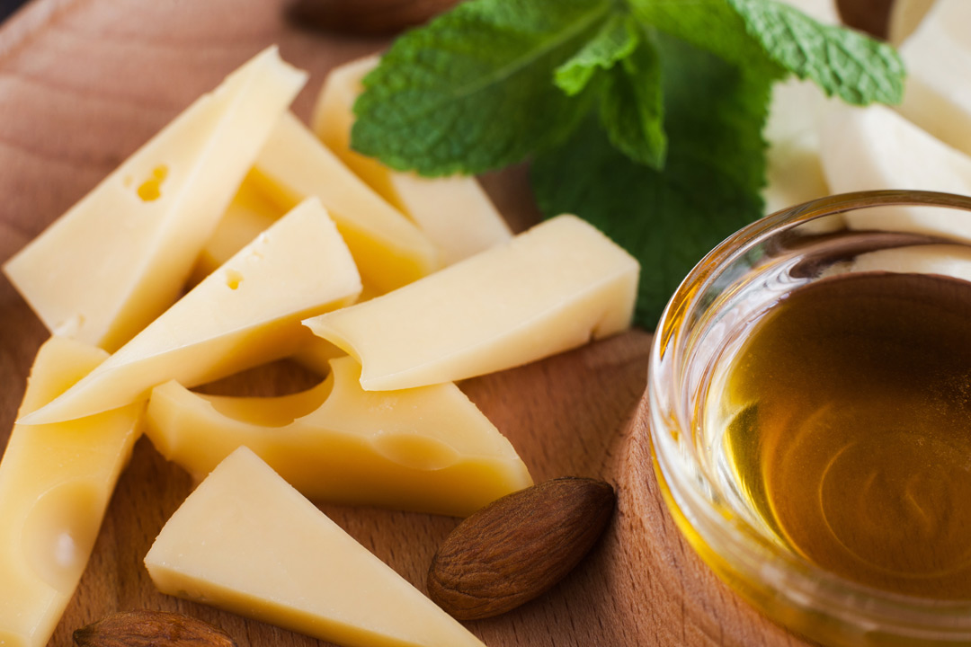 Gouda cheese, almond and a pot of olive oil
