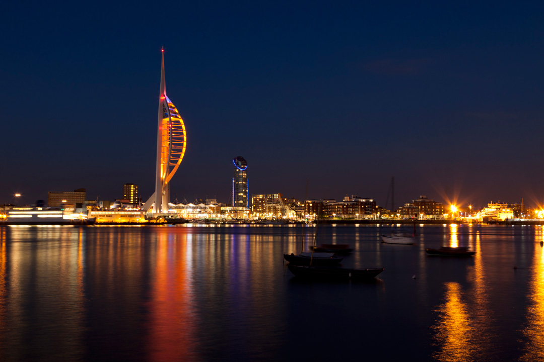 Portsmouth's Spinnaker tower and Portsmouth harbour illuminated at night