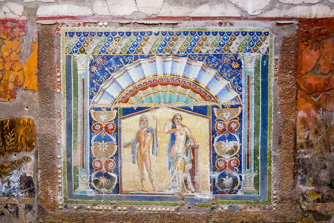 A colourful Roman mosaic depicting two nude figures