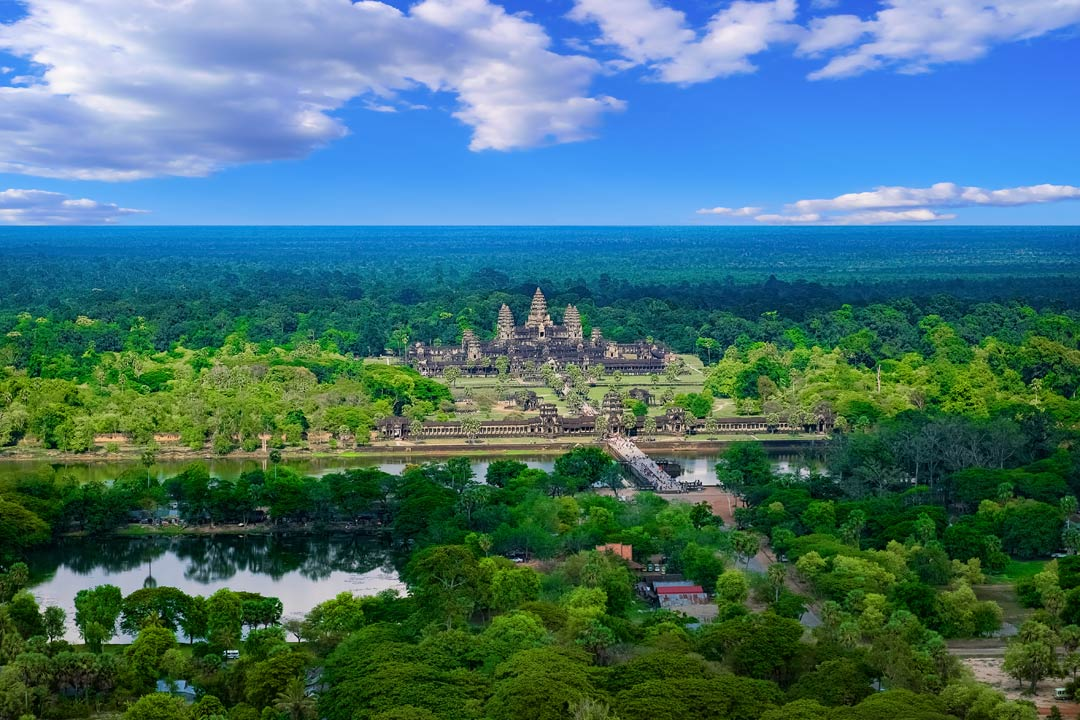 A panoramic view of Angkor Wat surrounded by jungle