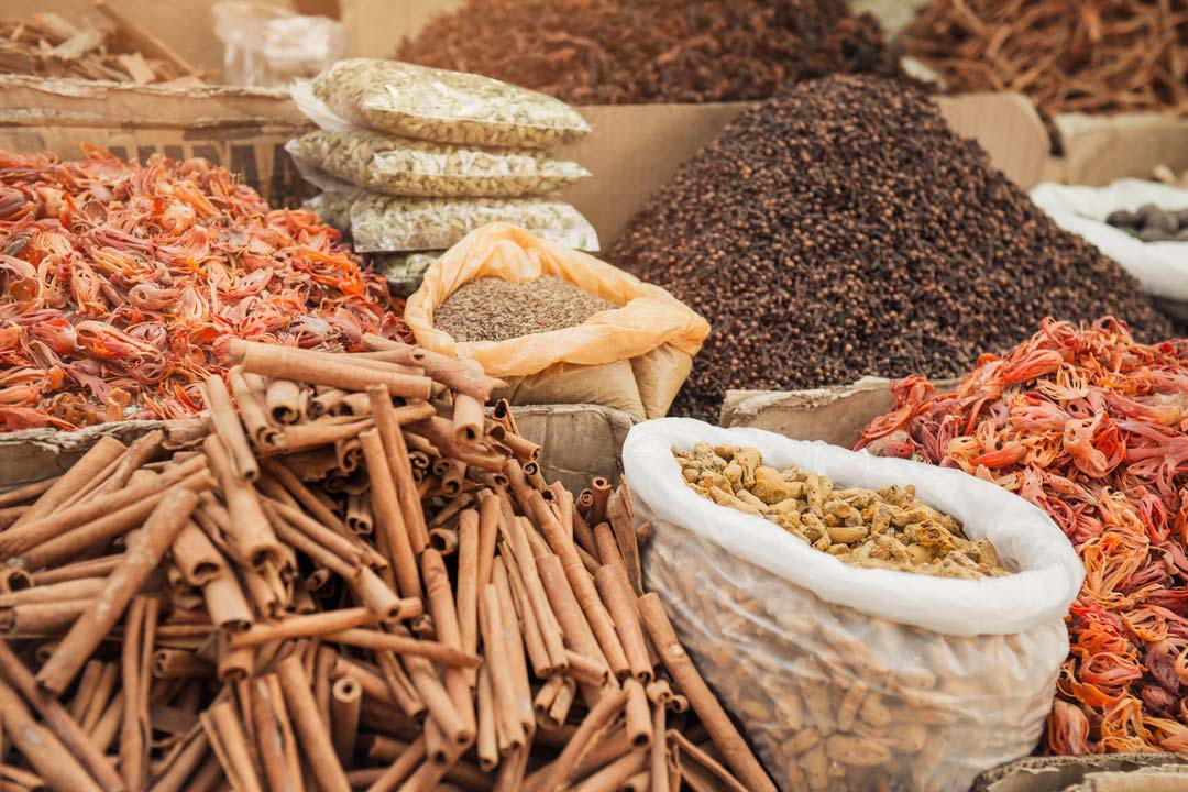 sticks of cinnamon and sacks of exotic spices in a market