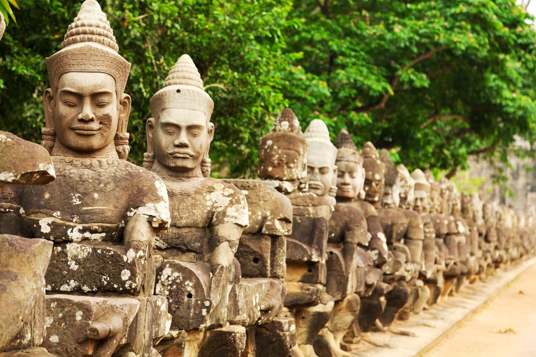 A row of Khmer statues tugging a rope