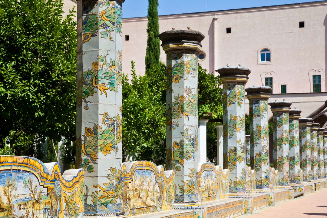 Old Roman style columns painted with colourful birds and flowers