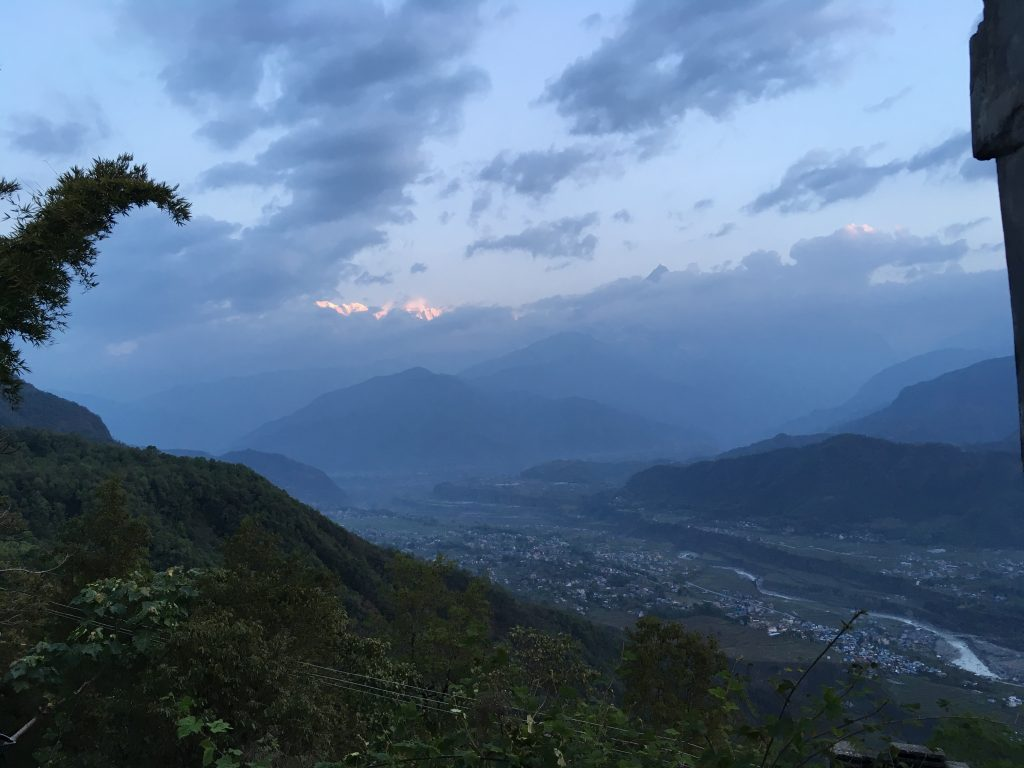 A stunning view in Pokhara, with a turquoise sky over lush mountainsides