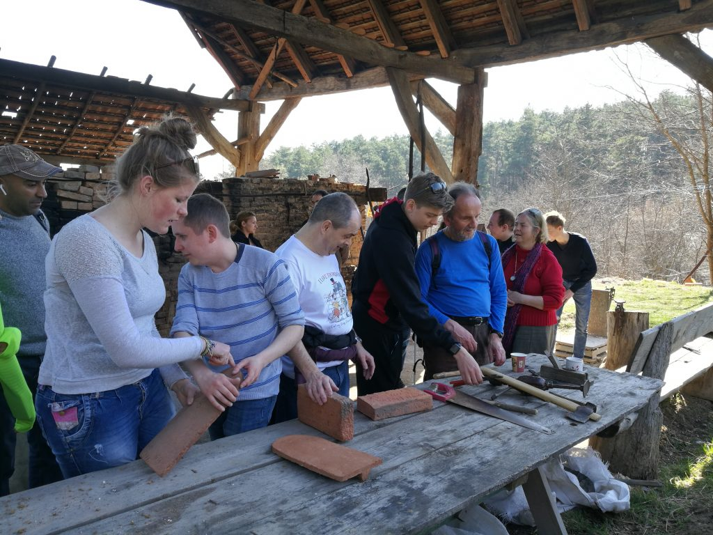 The students and VI's exploring traditional Romanian crafting tools and materials!