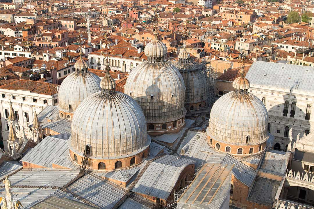 Venice's five giant domes, red tiled houses stretch into the background