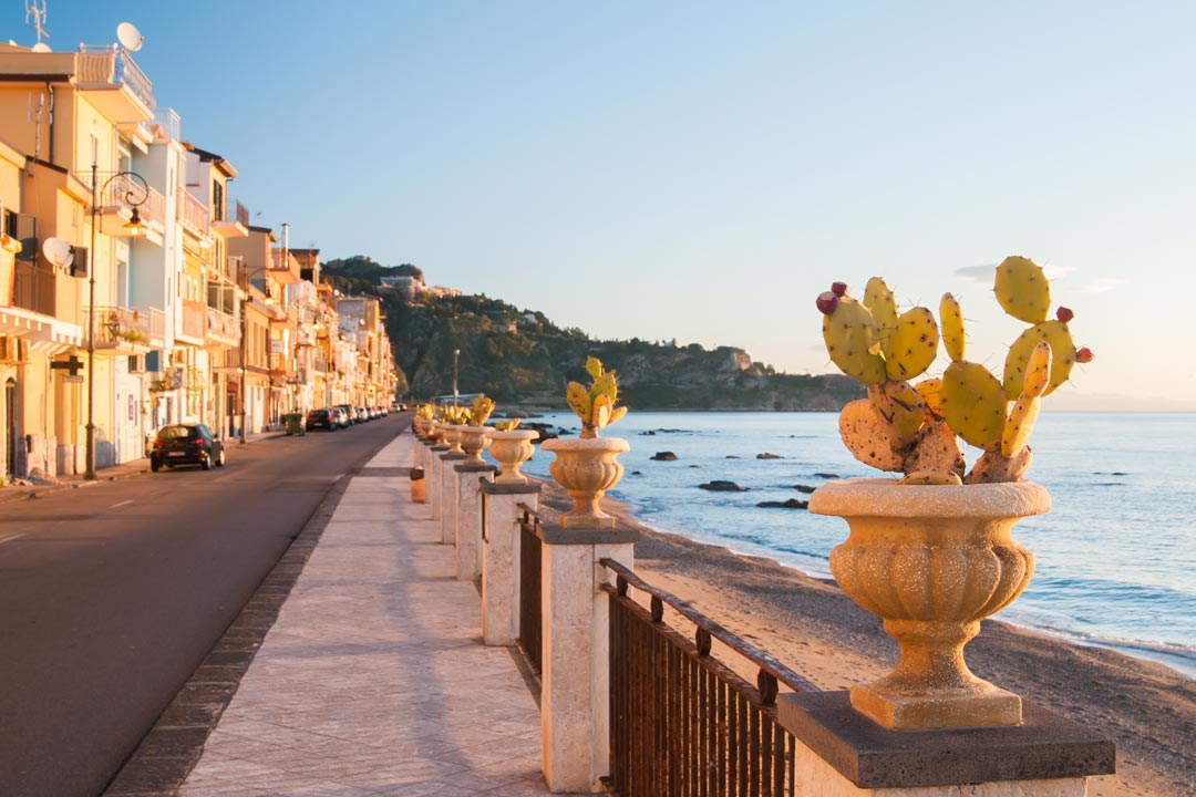The tranquil Mediterranean, with pastel coloured houses lining the coast