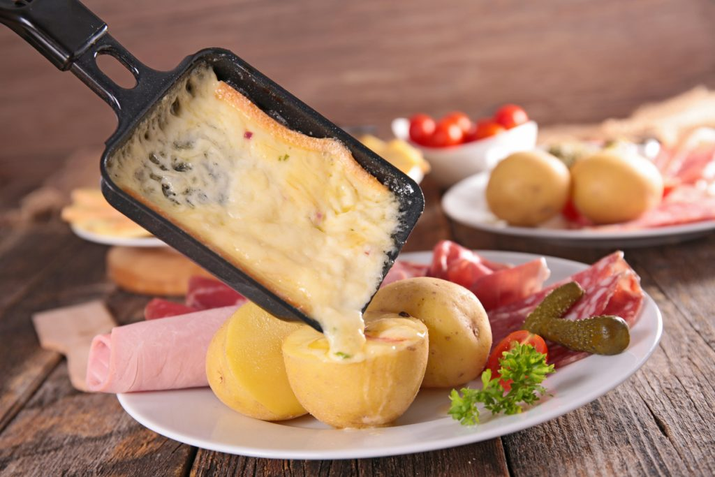 A classic raclette, melted and served over fresh potatoes
