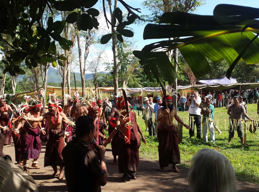 A tribal dance on the Island of Flores. The native people are dancing with swords and wearing traditional dress