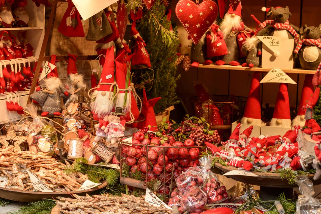 A market stall full of festive gifts and Christmas tree decorations