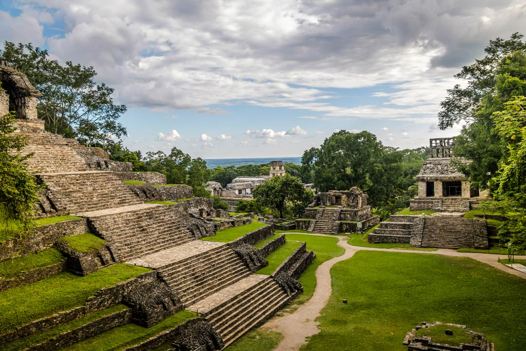 Ancient Mayan temples of stepped temples built in tiers being overgrown by jungle
