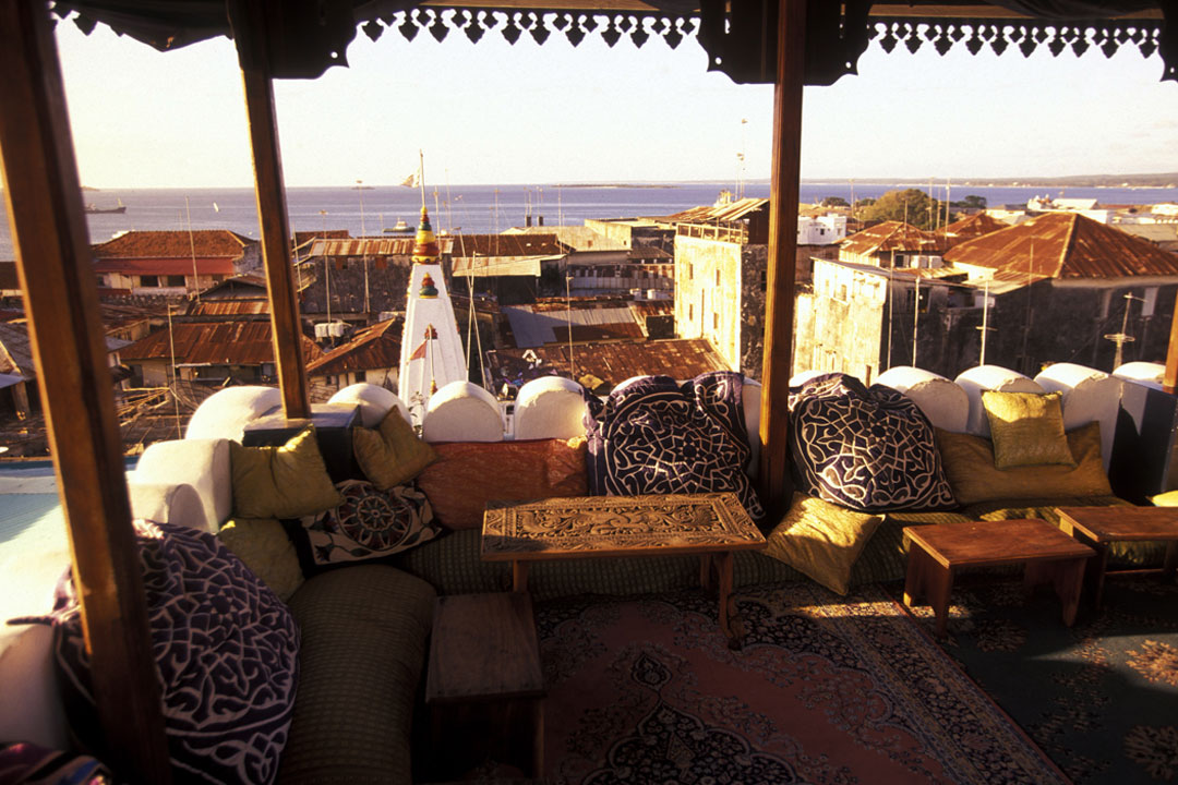 Cosy cushions lay on top of traditional carpets overlooking Stone Town