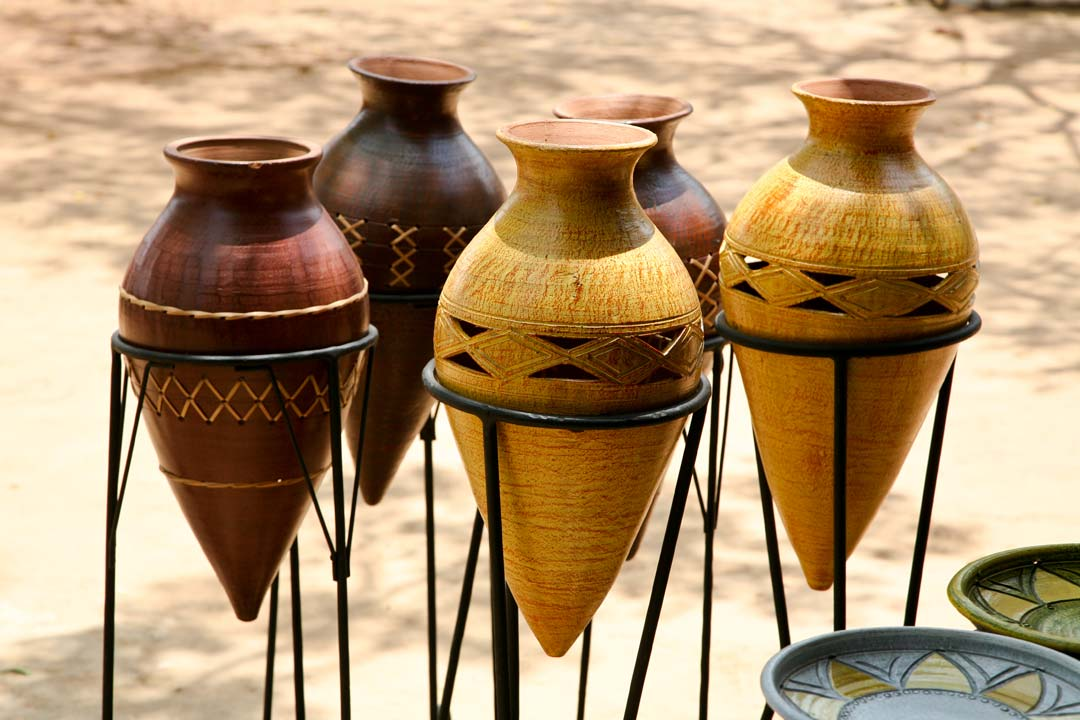 Four brown urns ready to be sold at a market stall