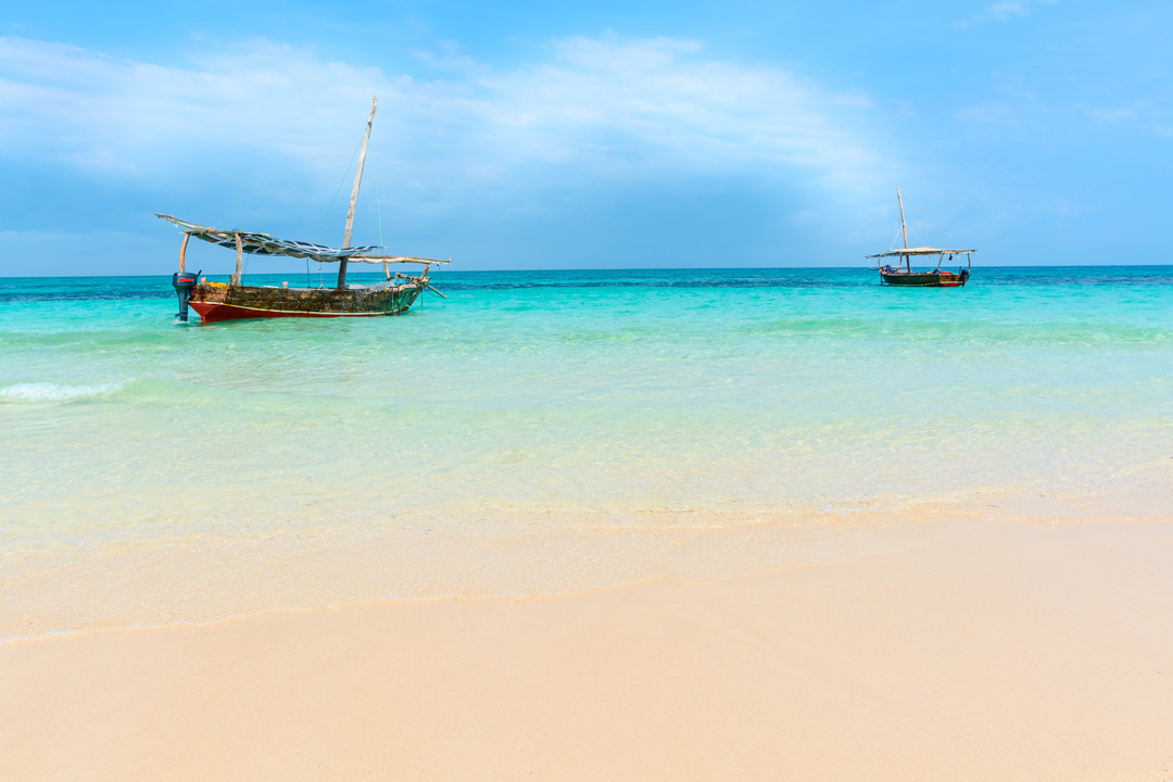 Two traditional fishing boats in the calm waters of the sea