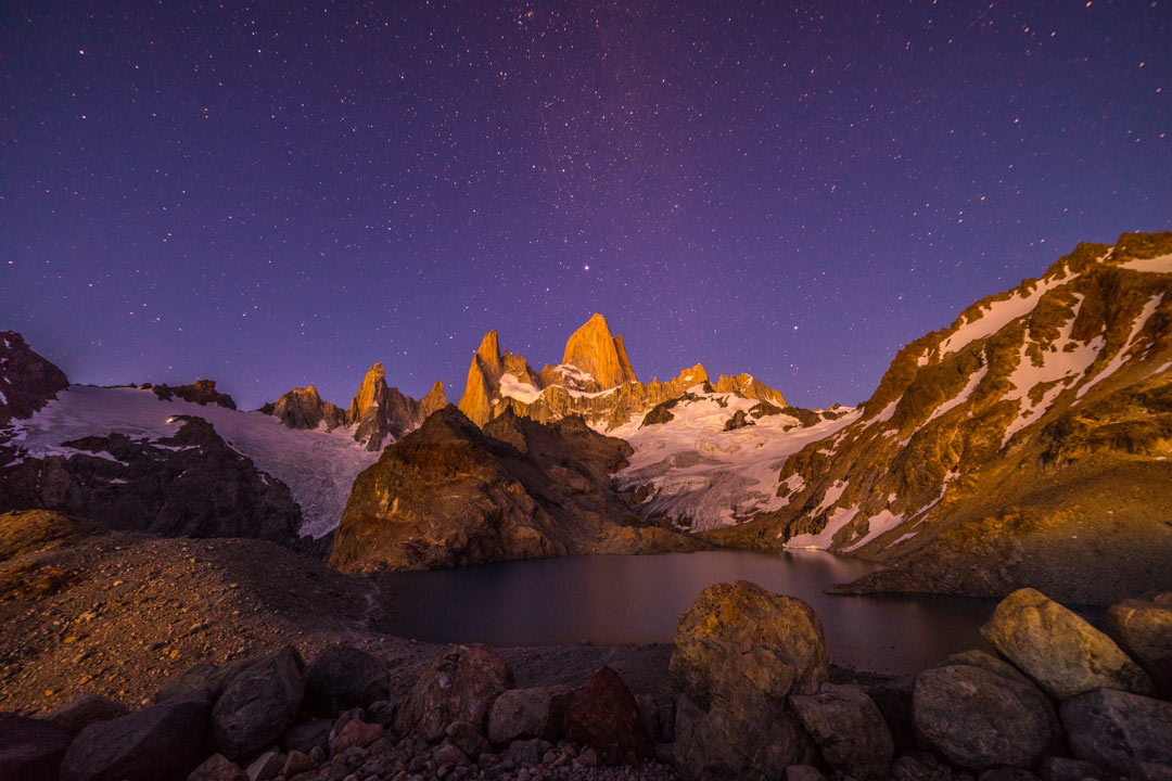 A starlit sky illuminating a rocky outcrop that forms around a watery tairn