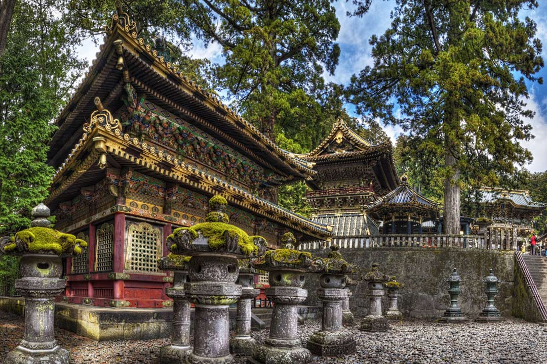 Moss covered shrines next to high tiered temples in Nikko