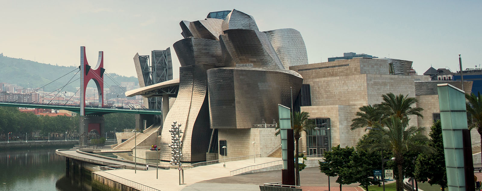 Shint metallic shapes form a daring facade for the Bilbao Guggenheim Museum