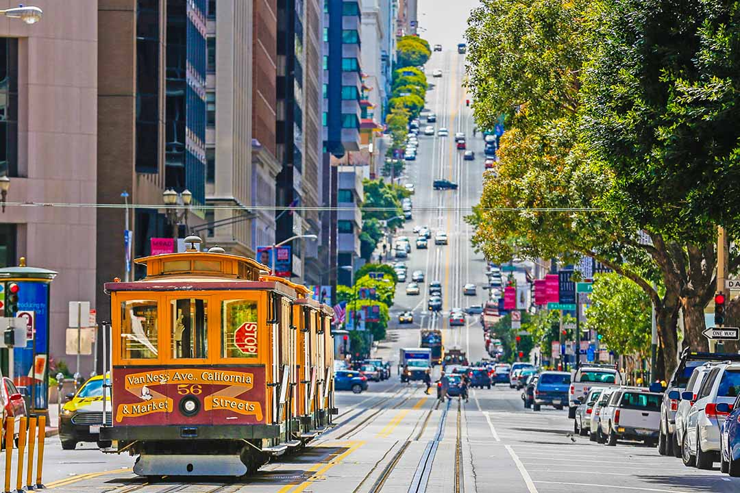 A colourful cable-car tram prepares to make its way up one of San Francisco's steep streets