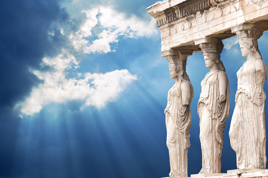 Three caryatids (pillars in the form of ladies) holding up a porch in the Erectheion on the Acropolis.