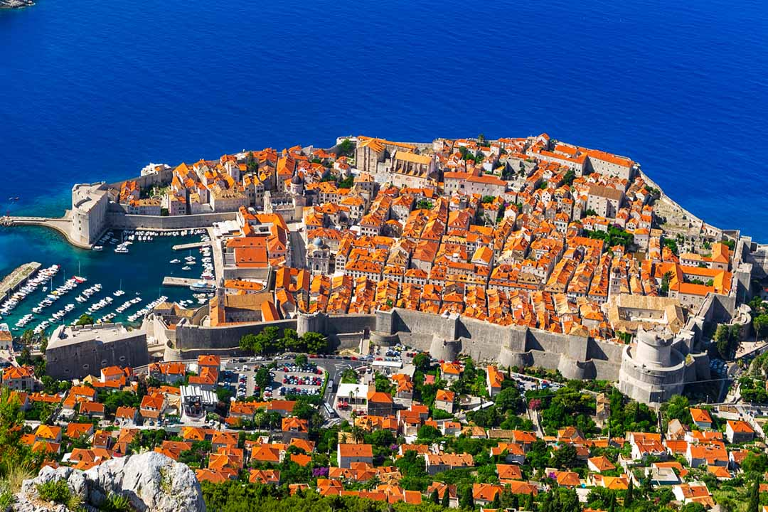 Image of Dubrovnik from above showing the thick walls and red-topped houses